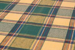 Tablecloth background. Checkered tablecloth texture as a background, closeup picture Royalty Free Stock Images