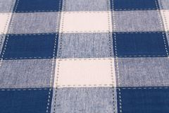 Tablecloth background. Checkered tablecloth texture as a background, closeup picture Royalty Free Stock Photography