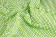 Tablecloth background. Checkered tablecloth texture as a background, closeup picture Stock Photos