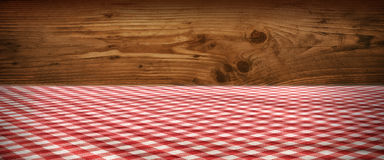Tablecloth checkered in front of wooden wall Stock Photography