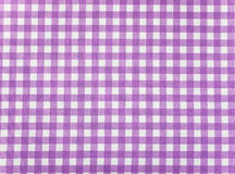 Tablecloth checkered purple and white texture background Stock Images