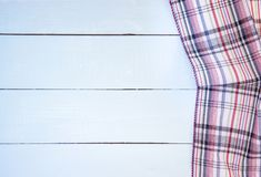 Tablecloth. Checkered tablecloth on wooden table Royalty Free Stock Photography
