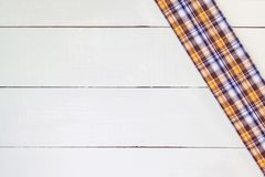 Tablecloth. Checkered tablecloth on wooden table Stock Image