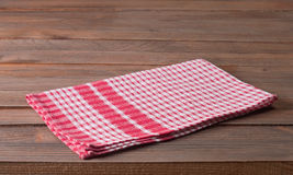 Tablecloth. Checkered tablecloth on wooden table Stock Photos