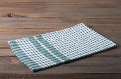 Tablecloth. Checkered tablecloth on wooden table Royalty Free Stock Images