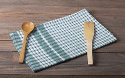 Tablecloth. Checkered tablecloth on wooden table Stock Photo