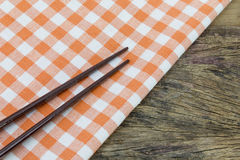 Tablecloth with chopsticks Stock Photography