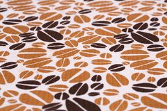 Tablecloth background. Tablecloth with coffee pattern  closeup picture Stock Image