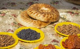 Tablecloth covered with Oriental sweets, nuts and lavash stock image