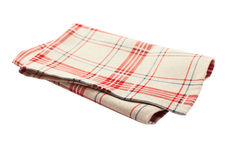 Tablecloth dishes. Linen tablecloth in red checkered for  dish on a white background isolated Royalty Free Stock Photo