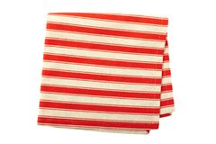 Tablecloth dishes. Tablecloth made of linen with red stripes for the dish on a white background isolated Royalty Free Stock Photography