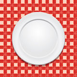 Tablecloth e placa vazia Fotos de Stock
