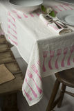 Tablecloth With Fork Design Laid on Table with Dinnerware. Tablecloth with fork patterns laid on table, dinnerware and napkin on top with wooden stool and crate Royalty Free Stock Images