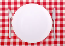 Tablecloth with fork, knife and an empty plate Stock Photos