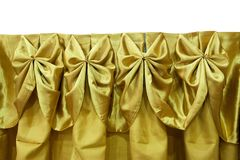 Tablecloth gold on table  on white background Royalty Free Stock Image