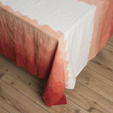 Tablecloth with Gradient Orange Zigzag Pattern Design. Tablecloth or linen with gradient orange zigzag pattern laid out on table Royalty Free Stock Photo