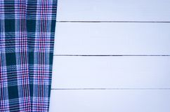 Tablecloth. Green checkered tablecloth on wooden table Stock Photography
