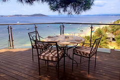 Tablecloth, iron chairs and sea view, Greece. Terrace cafe with tablecloth, iron chairs and sea view in Greece Royalty Free Stock Photos