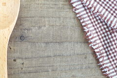 Tablecloth and old wooden table. Brown tablecloth and old wooden table background Stock Images