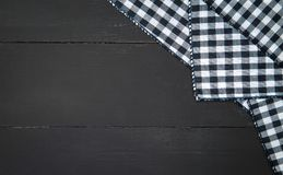 Tablecloth. The plaid tartan tablecloth on black wooden table in top view Stock Photo