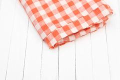 Tablecloth red and white checkered wavy on board. Tablecloth red and white checkered wavy Royalty Free Stock Images