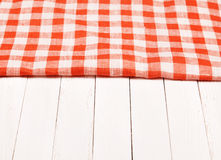 Tablecloth red and white checkered wavy on board. Tablecloth red and white checkered wavy on wooden board Stock Photo