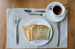 Tablecloth slice bread on white plate and tea cup Royalty Free Stock Photos