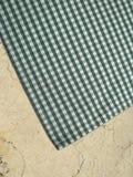Tablecloth on a stone worktop - folk pattern, green Royalty Free Stock Photos