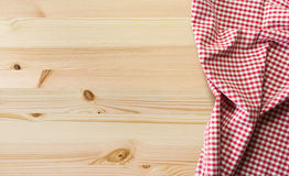 Tablecloth on table. Wooden table with checkered tablecloth for background Stock Images