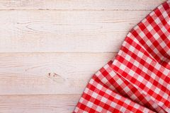 Tablecloth tartan on white wooden table. Flat mock. Up for design. Top view Royalty Free Stock Image