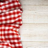 Tablecloth tartan on white wooden table. Flat mock Stock Images