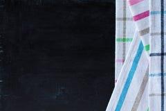 Tablecloth textile on blackboard Stock Photos