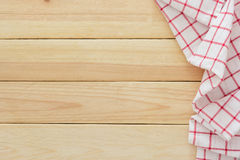 Tablecloth textile, checkered picnic napkin on wooden table background. Top view with blank space and text Stock Photos