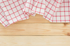 Tablecloth textile, checkered picnic napkin on wooden table background Stock Images
