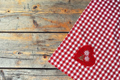 Tablecloth textile on a old wooden texture table. Stock Photos
