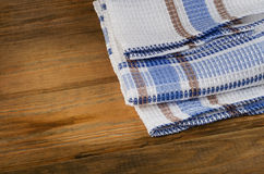 Tablecloth textile on a rustic wooden background Stock Photography