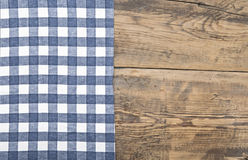 Tablecloth textile texture. On wooden table background Royalty Free Stock Photography