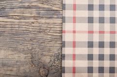 Tablecloth textile texture. On wooden table background Stock Image