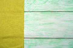 Tablecloth textile on wooden. Tablecloth green textile on wooden green background royalty free stock photography