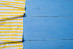 Tablecloth textile on wooden. Tablecloth yellow textile on wooden blue background royalty free stock photos