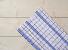 Tablecloth or towel over the wooden table Stock Photography