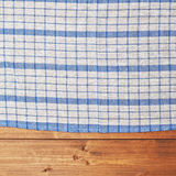 Tablecloth or towel over the wooden table Royalty Free Stock Image