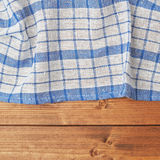 Tablecloth or towel over the wooden table Royalty Free Stock Images