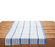 Tablecloth or towel over the wooden table. Blue tablecloth or towel over the surface of a brown wooden table, composition isolated over the white background Stock Photos