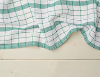 Tablecloth or towel over the wooden table Stock Photos