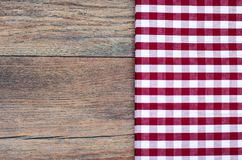Tablecloth in white and red cage on wooden table. Studio Photo Royalty Free Stock Image