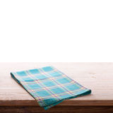 Tablecloth on wooden deck table, white background. Stock Photos