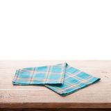 Tablecloth on wooden deck table, white background. Royalty Free Stock Image