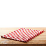 Tablecloth on wooden deck table, white background. Tablecloth on wooden deck table on white background. Mockup for design Stock Images