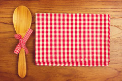 Tablecloth and wooden spoon for cooking and baking Royalty Free Stock Image